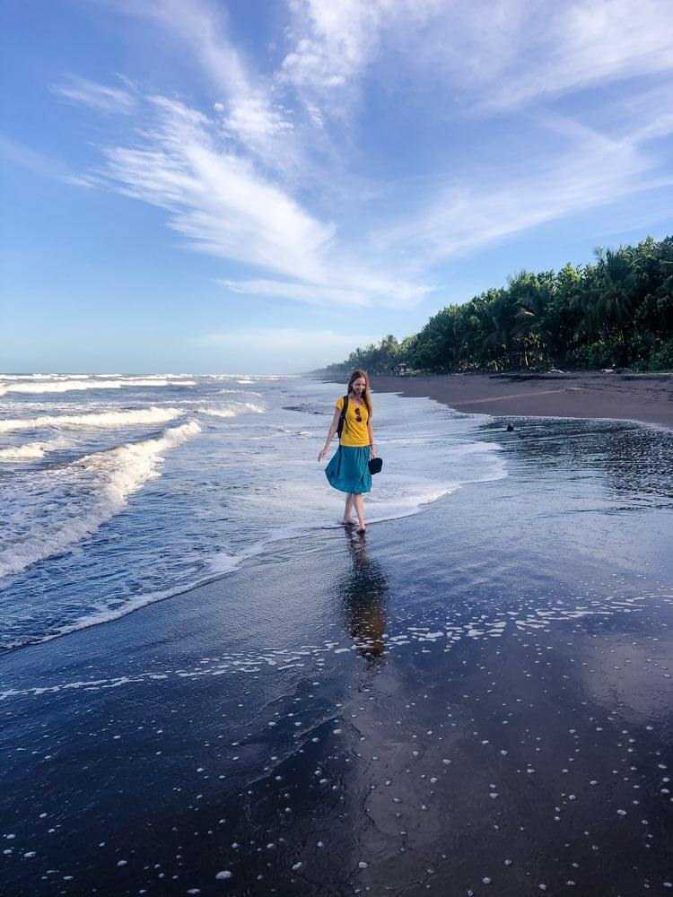 Veronika walking on a beach in Tortuguero Costa Rica