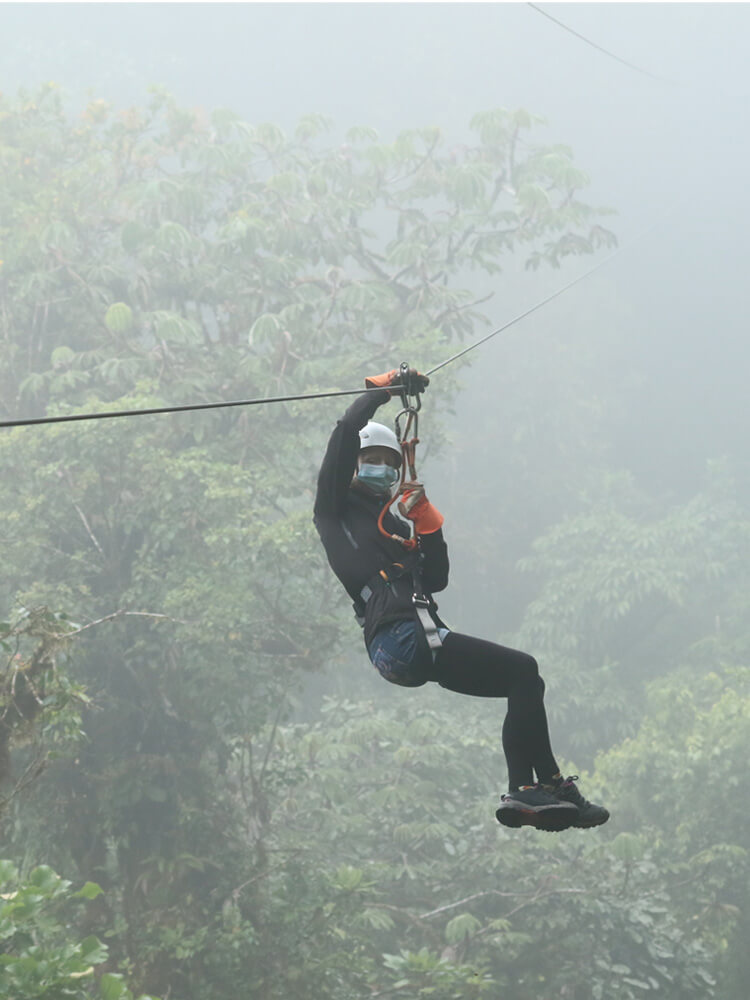 Canopy tour (zipline) in a foggy cloud forest in Costa Rica