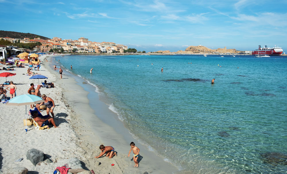 People on Ile-Rousse City Beach in Corsica