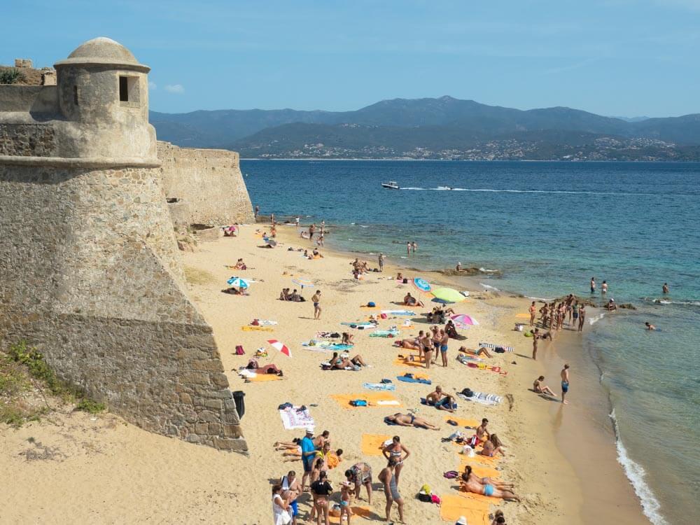 People enjoying beach in the city of Ajaccio in Corsica