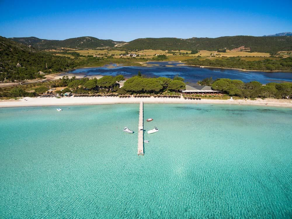A white sand beach and a freshwater lagoon behind - Corsica, France