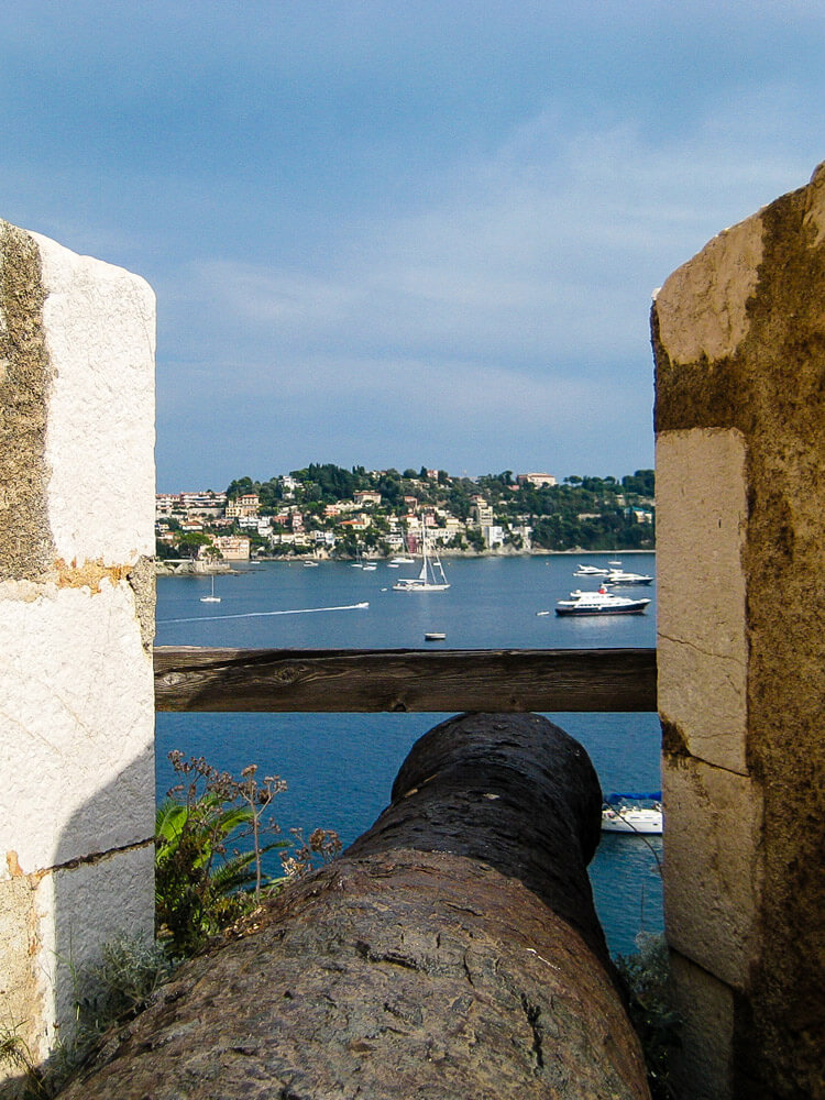 A cannon sticking out of a citadel