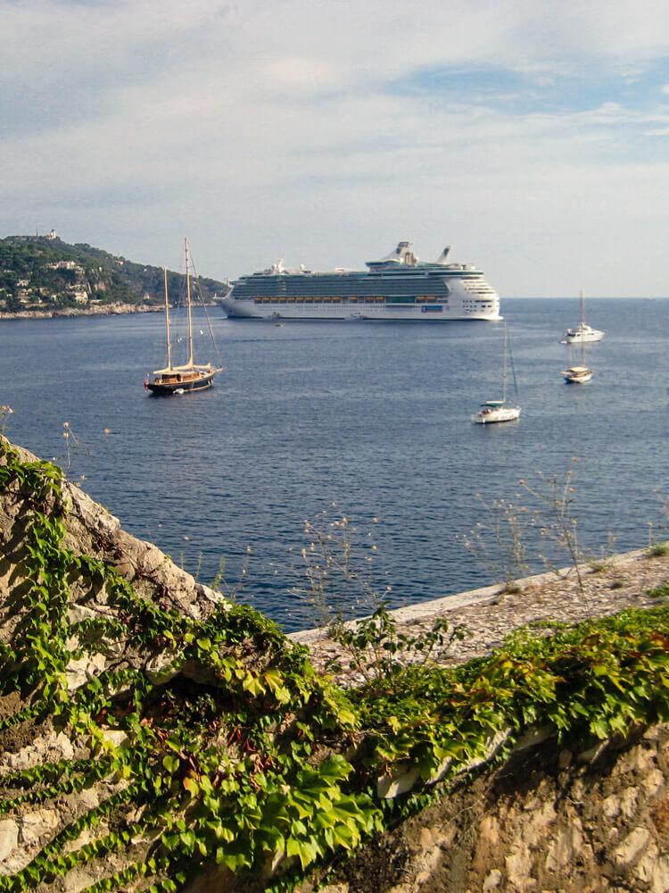 A large cruiseship anchored near the coast