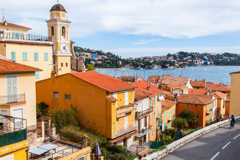 View of colorful houses and a church tower in Villefranche sur Mer, France
